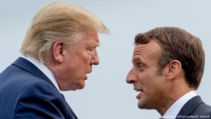 US President Donald Trump speaks with French President Emmanuel Macron at the G7 summit in Biarritz, France