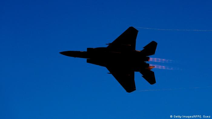 An Israeli jet flies through the sky