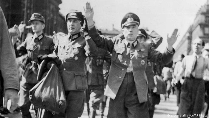 In this August 28, 1944, file photo, high-ranking German officers captured by French patriot forces in Paris are marched through the streets of the French capital with their hands in the air