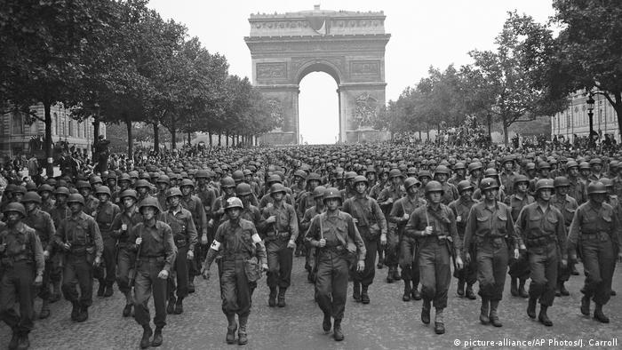 US troops march down the Champs Elysees in Paris, France, on August 29, 1944, after the city's liberation