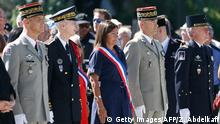 Paris Mayor Anne Hidalgo attends a ceremony at the base of the Eiffel Tower to commemorate the 75th anniversary of the liberation of Paris