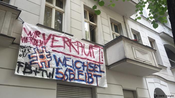 protest banner hanging out of window
