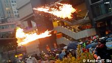 An anti-extradition bill protester throws a Molotov cocktail as protesters clash with riot police during a rally to demand democracy and political reforms, at Tsuen Wan, in Hong Kong, China August 25, 2019. REUTERS/Tyrone Siu TPX IMAGES OF THE DAY