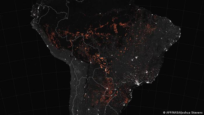 A NASA Earth Observatory map showing active fire detections in South America,