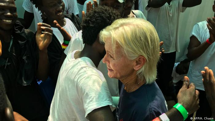 MSF-nurse Mary jo Frawley embraces Sudanese refugee Omar on board the Ocean Viking - 15 years after their first encounter