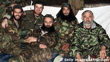 -, RUSSIAN FEDERATION: (FILE) An undated file picture shows Chechen rebel leaders Shamil Basayev (C), Aslan Maskhadov (R), Abu Al Valid (2nd R) and two unindetified rebels photographed in a camp in the mountains of Chechnya. Federal forces and members of the Chechen president's security service killed nine gunmen included Abu Al Valid in the number of Chechen villages during night operation 24 September 2004. The militants were killed during a security sweep aimed at locating and detaining members of illegally armed formations, spokesman for headquarters of the federal forces in the region Major-General Ilya Shabalkin told Tass. AFP PHOTO / HO (Photo credit should read STRINGER/AFP/Getty Images)