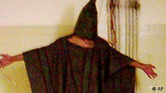 This is an image obtained by The Associated Press which shows an unidentified detainee standing on a box with a bag on his head and wires attatched to him in late 2003 at the Abu Ghraib prison in Baghdad, Iraq. (AP Photo)