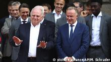 Bayern Munich President Uli Hoeness, left, gestures besides CEO Karl-Heinz Rummenigge during a reception for his soccer club at the Bavarian Chancellery in Munich, Germany, Wednesday, Aug. 28, 2019. (AP Photo/Matthias Schrader)  