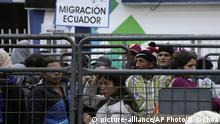 Venezuelans wait outside an immigration processing office on the Rumichaca bridge after crossing the border from Colombia to Rumichaca, Ecuador, Wednesday, June 12, 2019. Many of the Venezuelan migrants arriving here are making their way to Peru, where on June 15, the country will start requiring them to have a passport and humanitarian visa. Currently they can enter Peru with their national Venezuelan identification cards. (AP Photo/Dolores Ochoa)  