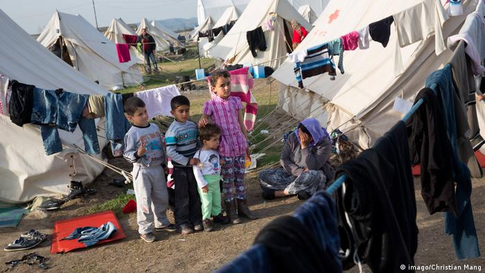 Children in a refugee camp in Nea Kavala, Greece