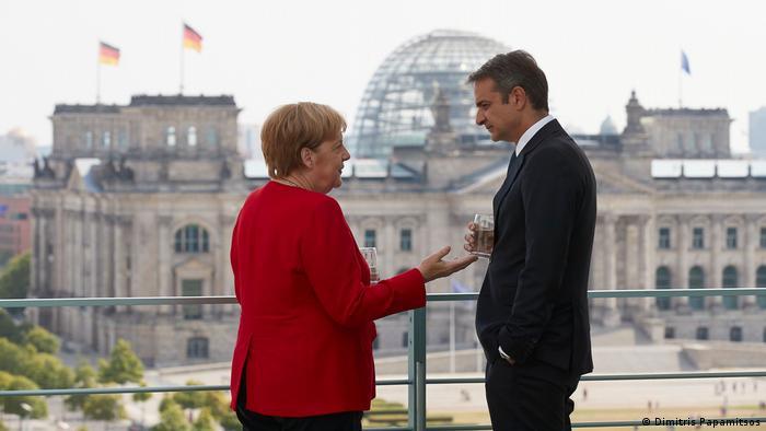 Kyriakos Mitsotakis with German Chancellor Angela Merkel during a visit to Berlin