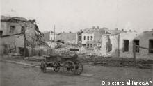 In this Sept. 1 1939 archive photo made available by the Museum of Wielun destroyed houses bombed in the center of Wielun, Poland by the German Luftwaffe in the very first bombing of World War II are seen . (AP Photo/ HO Museum of Wielun) |