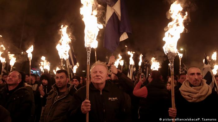 Golden Dawn supporters hold torches during the annual Imia march in 2017
