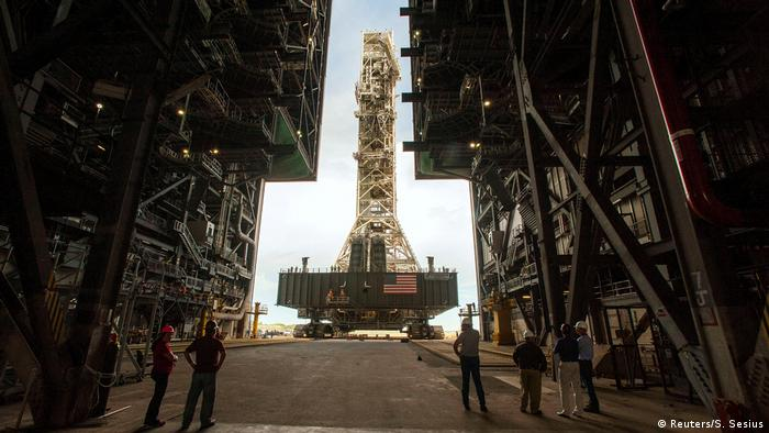 NASA employees look on as the Artemis launch tower rolls back (Reuters/S. Sesius)