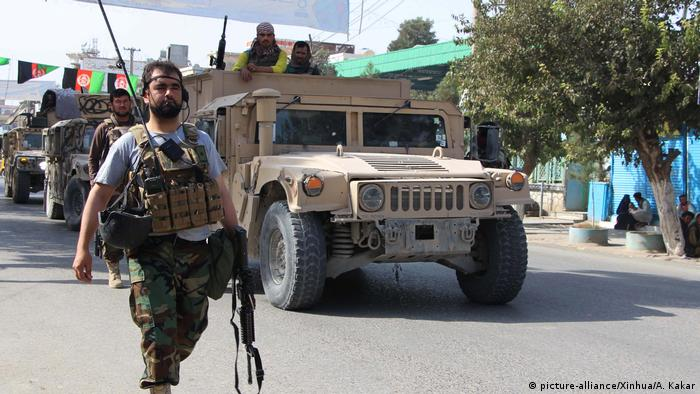 Afghan soldiers take part in an operation against Taliban militants in Kunduz city