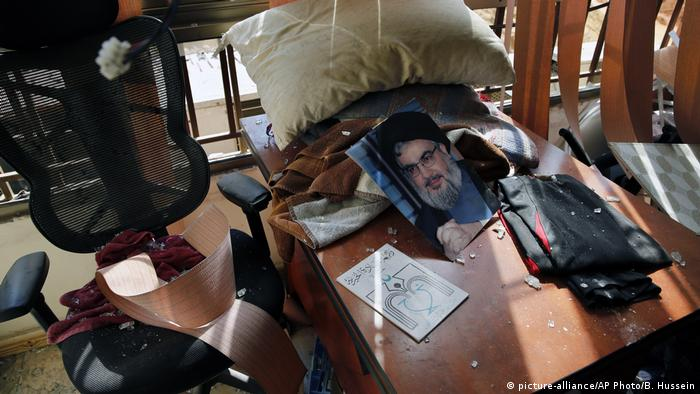 A picture of Hezbollah leader Sayyed Hassan Nasrallah lies amid other damage inside the Lebanese Hezbollah media office, in a southern suburb of Beirut, Lebanon