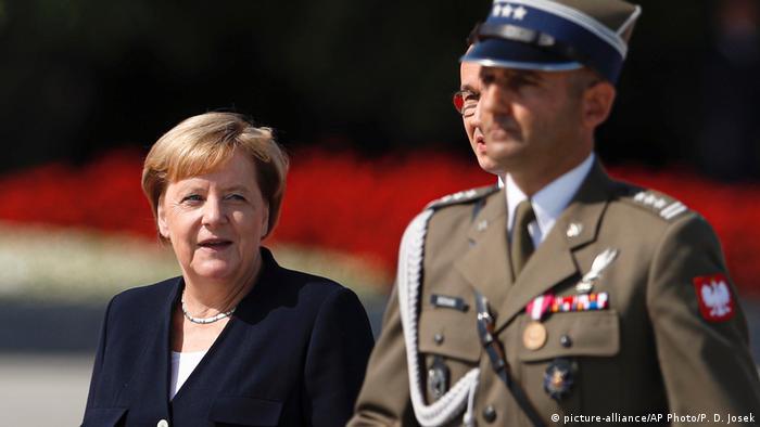 Germany's Chancellor Angela Merkel with Polish Prime Minister Mateusz Morawiecki