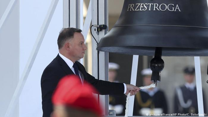 Polish President Andrzej Duda rings the Bell of Memory and Warning