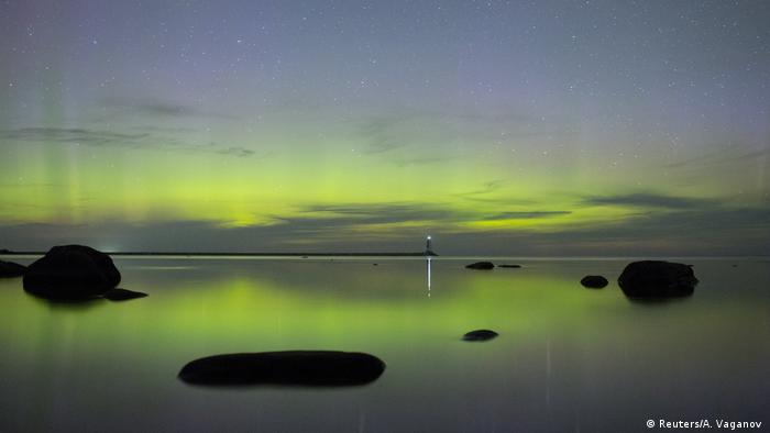 The northern lights seen in the sky over Lake Ladoga in Leningrad Region, Russia (Reuters/A. Vaganov )