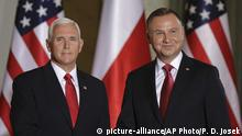 U.S. Vice President Mike Pence, left, shakes hands with Polish President Andrzej Duda in Warsaw, Poland, Monday, Sept. 2, 2019. The U.S. and Poland signed an agreement on Monday to cooperate on new 5G technology amid growing concerns about Chinese telecommunications giant Huawei. (AP Photo/Petr David Josek) |