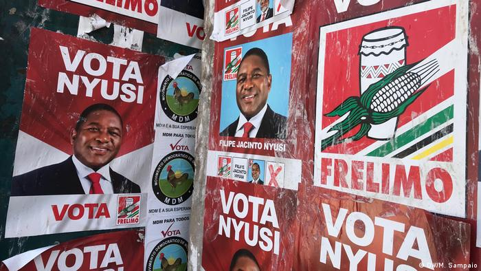 Posters calling for a vote for President Nyusi of Mozambique