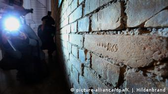Photographers take pictures of the engraved brick in Neuschwanstein Castle