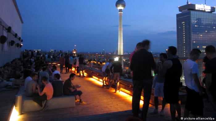 Outdoor terrace at a party at Berlin's House of Weekend club, with television tower in background.