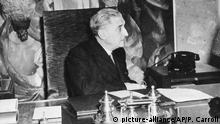 Dr. Antonio de Oliveira Salazar, Prime Minister of Portugal, seen around Feb. 24, 1946, at his office desk in the Palace of San Bento, where the Portuguese National Assembly sits in Lisbon. (AP Photo/Peter J Carroll) |