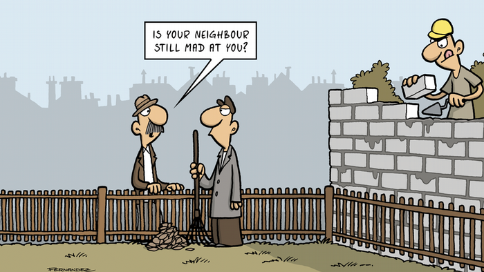 Fernandez cartoon: a man building a wall while two others talk at a fence