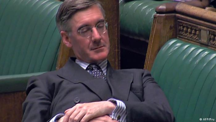 Jacob Rees-Mogg reclines on a bench during a Brexit debate in Parliament