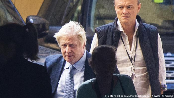 UK. Prime Minister Boris Johnson (L) arrives at Parliament watched by his special advisor Dominic Cummings