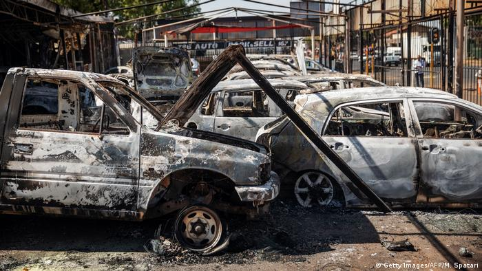 Dozens of burnt-out cars litter a car dealership in Jonannesburg
