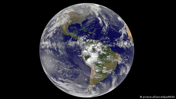 A photo of the earth from space. The continent of South America is in view.