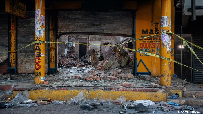 The scene of a looted shop where the body of a burned person was found is seen in Alexandra township, Johannesburg