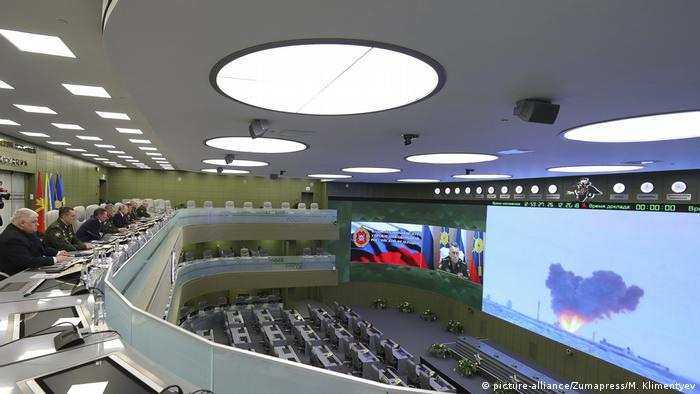 Russian officials watch a video feed of a test firing of the Avangard hypersonic glide vehicle