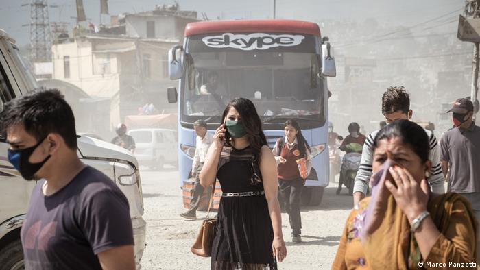 People with air pollution masks on their faces in dusty Kathmandu