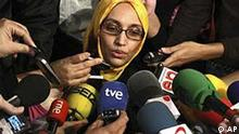 Aminatou Haidar, a western Sahara independence activist who has been on a hunger strike for over a month, speaks to the press after leaving a hospital, in Lanzarote, Spain, Thursday, Dec. 17, 2009. Spanish news reports say an activist from the disputed territory of Western Sahara who has been on hunger strike in Spain for a month has been flown back home. (AP Photo/Jose Rueda)