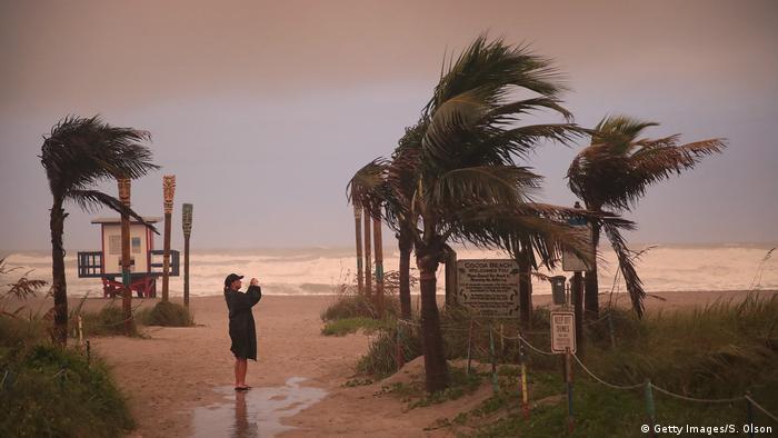 A woman at a beach in Florida, USA, as Hurricane Dorian approaches