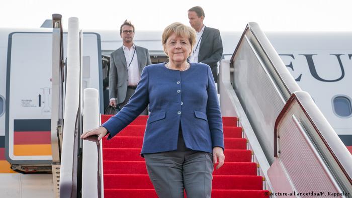 Канцлер Германии Ангела Меркель в аэропорту Пекина
