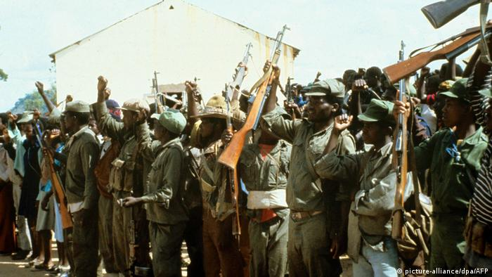 Resistance fighters surrender their weapons on 07.02.1980.
