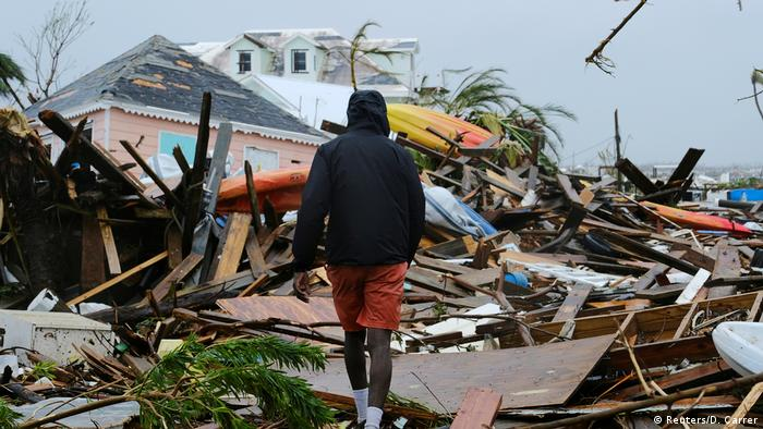 A man walks through the rubble in the aftermath of Hurricane Dorian on the Great Abaco island town of Marsh Harbour (Reuters/D. Carrer)