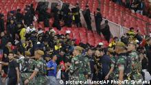 Indonesian army and police officers escort supporters of Malaysia's team after Malaysia beat Indonesia during their World Cup Group G Asia qualifying at Gelora Bung Karno Stadium in Jakarta, Indonesia, Thursday, Sept. 5, 2019. The game had to be temporarily halted because of crowd trouble. (AP Photo/Tatan Syuflana) |
