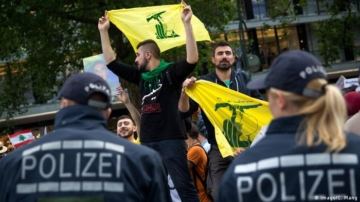Al Quds Day in Berlin in 2017, with police in foreground and demonstrators with Hezbollah flages in the background