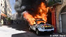 07.09.2019 A picture taken on September 7, 2019 shows a burning French Municipal Police car on the sidelines of an anti-government demonstration called by the Yellow Vests (Gilets Jaunes) movement in Montpellier, southern France. (Photo by Pascal GUYOT / AFP)