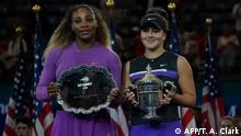 07.09.2019 Bianca Andreescu of Canada (R) poses with the trophy after she won against Serena Williams of the US after the Women's Singles Finals match at the 2019 US Open at the USTA Billie Jean King National Tennis Center in New York on September 7, 2019. (Photo by TIMOTHY A. CLARY / AFP)