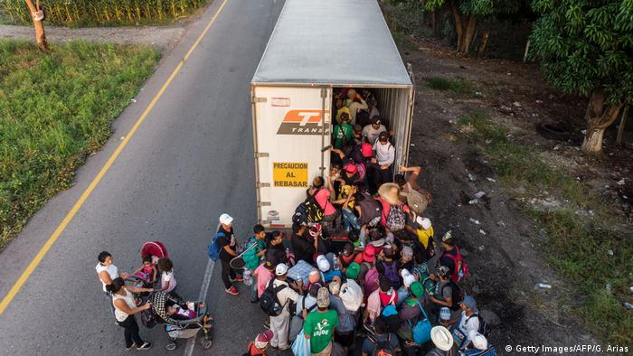 Migrants from Central American climb into a truck in a bid to reach the US border (Getty Images/AFP/G. Arias)