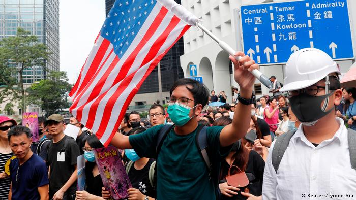 Hong Kong protesters waved American flags during a pro-democracy rally on Sunday