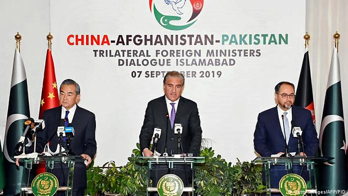 Pakistan Foreign Minister Shah Mahmood Qureshi (C) and Chinese Foreign Minister Wang Yi (L) along with Afghanistan Foreign Minister Salahuddin Rabbani (R) answer the press after the 3rd round of China-Afghanistan-Pakistan Trilateral Foreign Ministers Dialogue in Islamabad