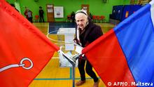 September 8, 2019*** A woman prepares to cast her vote at a polling station during the governor's election in Saint Petersburg on September 8, 2019 as part of the Russian local and regional elections today. (Photo by Olga MALTSEVA / AFP)