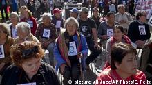 In this May 18, 2019 photo, Marta Perez, 83, center, attends a memorial for the murdered members of the Central Committee of the Communist Party, including her husband Uldaricio Donaire, who were tortured and killed in 1976 by the National Directorate of Intelligence (DINA) in Santiago, Chile. During the Pinochet dictatorship, at least 3,095 people were killed, according to government figures, and tens of thousands more were tortured or jailed for political reasons. (AP Photo/Esteban Felix) |